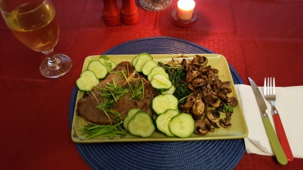 T-bone steak with mushroom sauce, spinach, and fresh cucumbers and cilantro grown from my own garden!!!